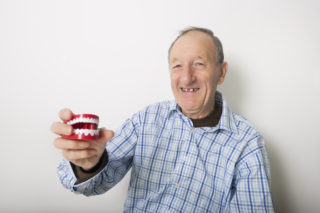 How Dentures Can Improve Your Oral Health Over Having Missing Teeth